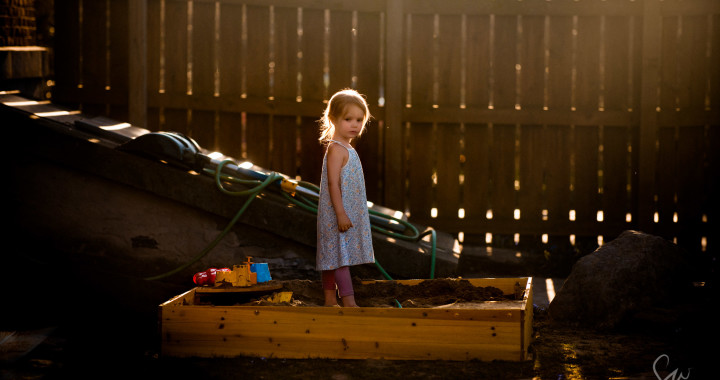 Backlit-Little-Girl-with-Tiny-Braids-Playing-in-Sandbox-in-Beautiful-Light-at-Golden-Hour-with-Shadows-and-Colors-by-Sarah-Wilkerson-
