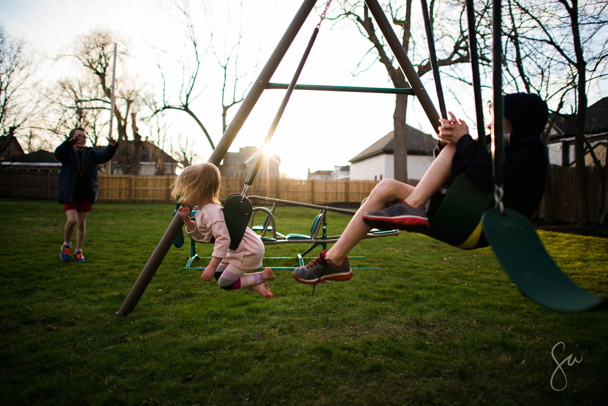 Children-Playing-on-Swingset-on-a-Cool-Spring-Evening-at-the-end-of-Golden-Hour-4781