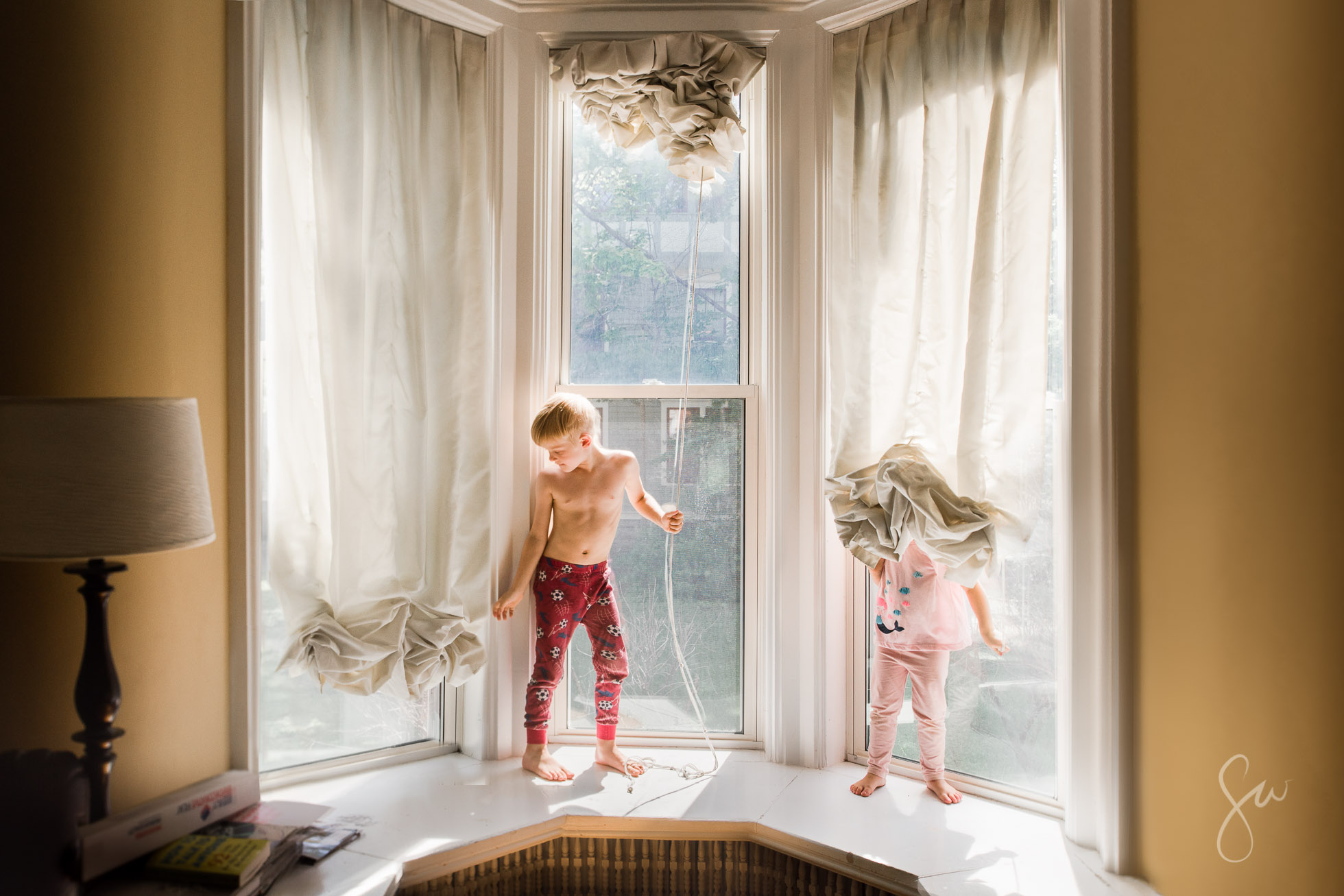 Everyday-Life-Photo-of-Children-Playing-in-Clean-Glow-of-Beautiful-Natural-Window-Light-by-Sarah-Wilkerson-
