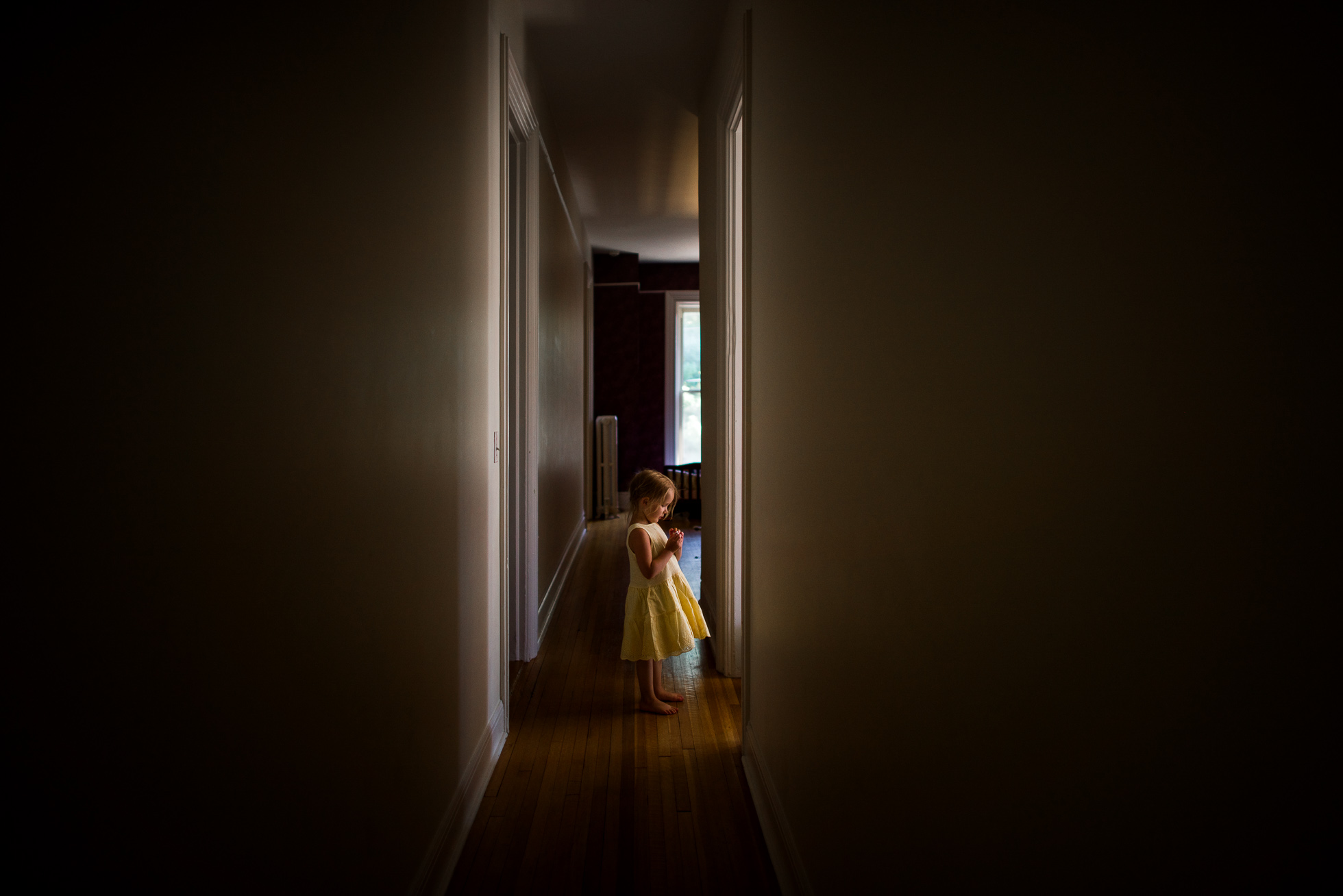 Girl-in-Yellow-Dress-Framed-by-Tall-Hallway-and-Standing-in-Beautiful-Natural-Sidelighting-by-Sarah-Wilkerson-7780