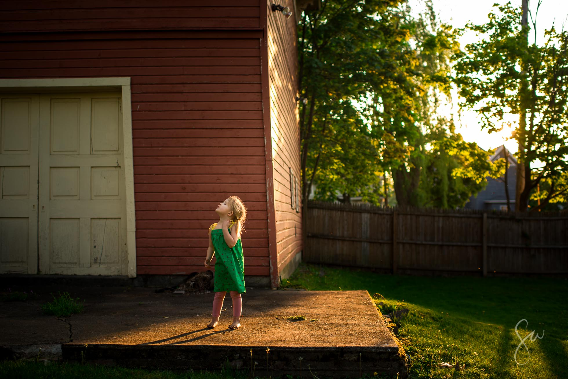 Little-Girl-in-Green-Dress-Standing-in-Evening-Golden-Backlighting-by-Sarah-Wilkerson-2