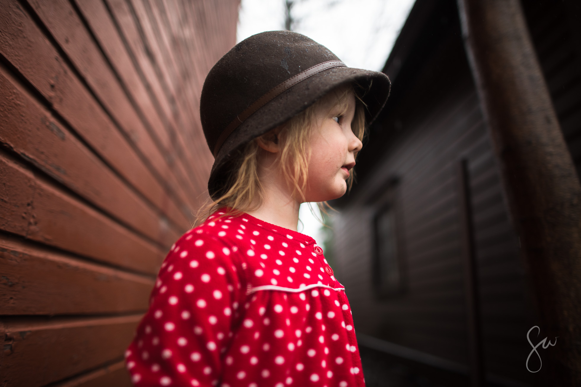 Little-Girl-in-Polka-Dots-Red-Boots-and-a-Cloche-Hat-Playing-outside-on-a-rainy-day-3764