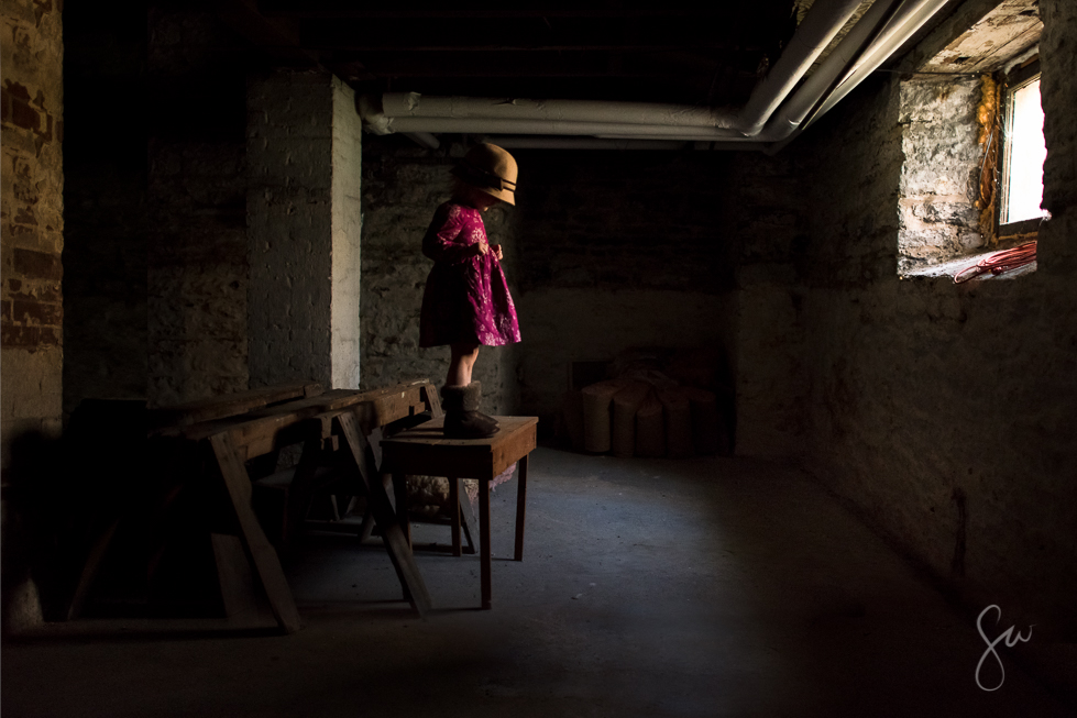Low-Light-Photo-of-Little-Girl-Wearing-Purple-Dress-in-Old-Basement.jpg-