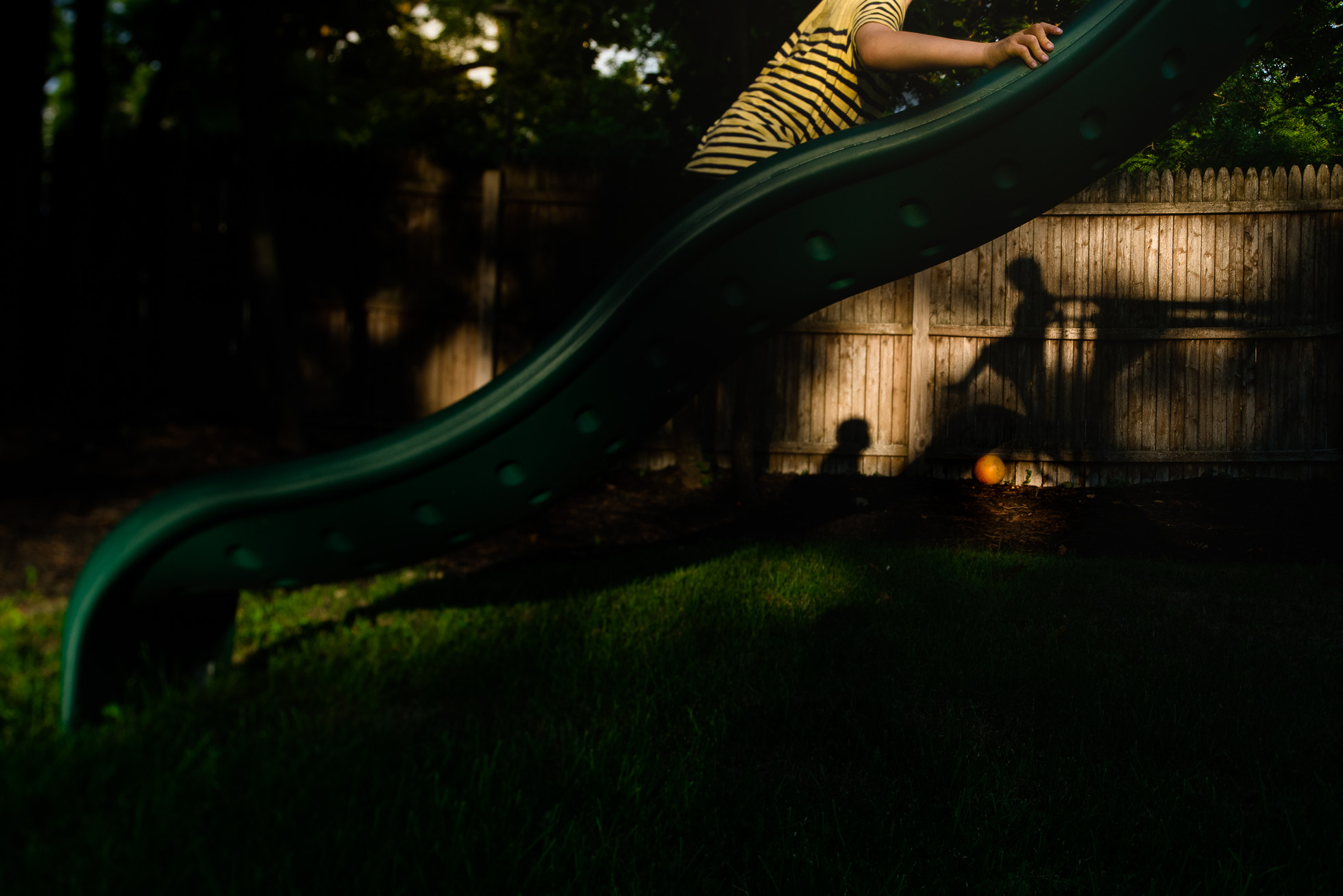 tilt-shift-photo-with-unconventional-composition-and-shadows-on-backyard-slide-by-sarah-wilkerson-0127