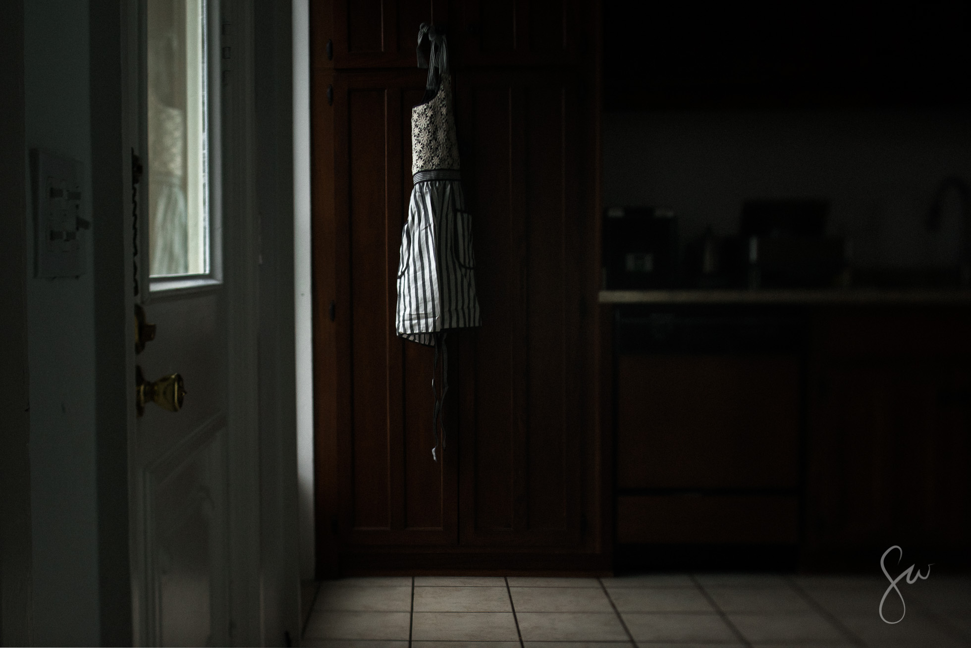 Vintage-Lace-Striped-Apron-and-Dramatic-Low-Light-with-Natural-Light-Windows-in-Kitchen-3970