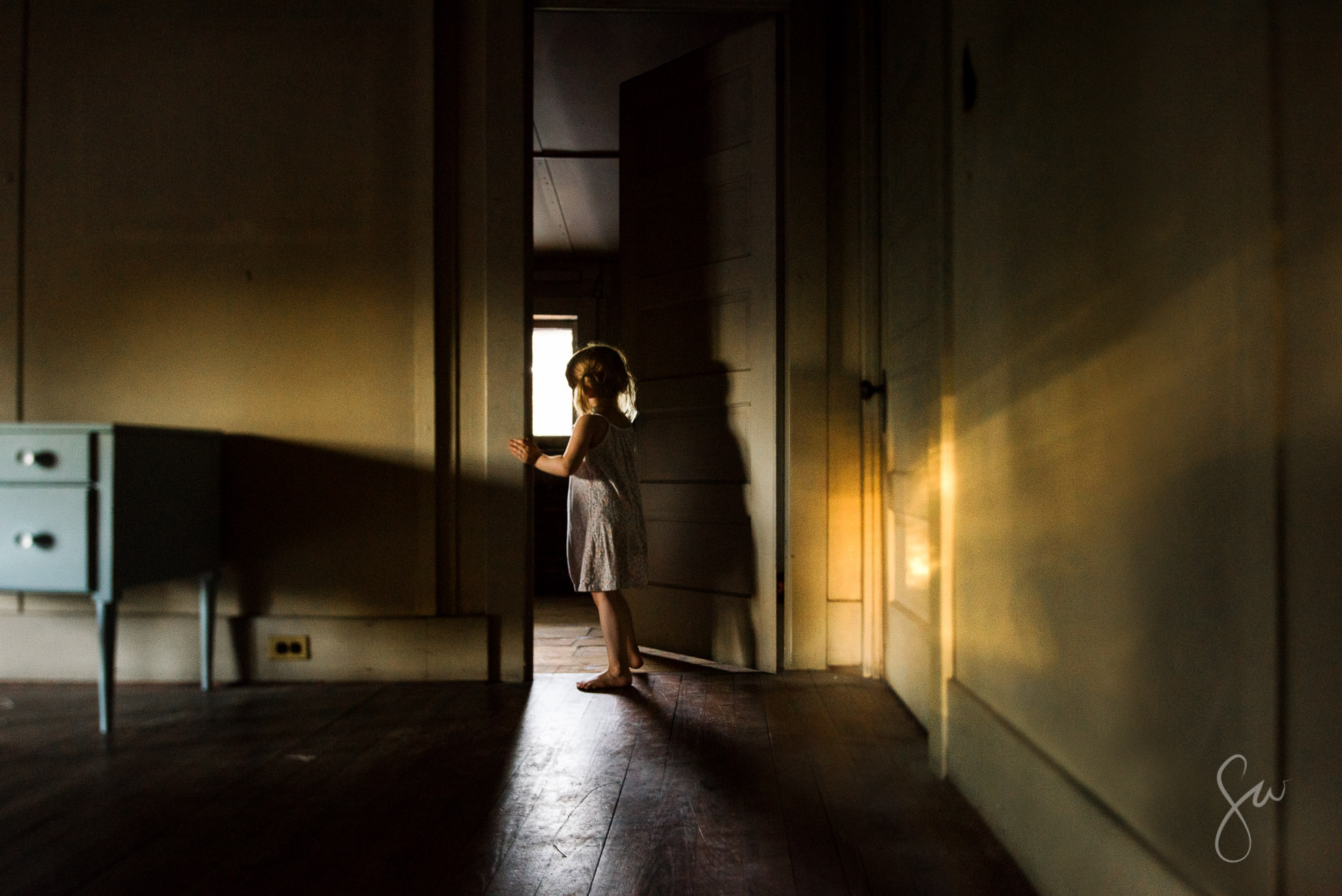 Low-Light-Tilt-Shift-Child-Environmental-Portrait-with-Amazing-Reflected-Evening-Golden-Light-in-Spooky-Historic-Attic-by-Sarah-Wilkerson-